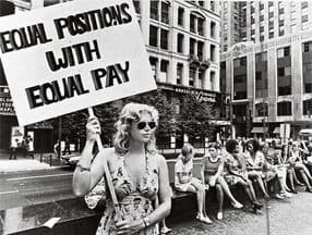A woman demanding equal pay. NY Times / Bentley.edu.